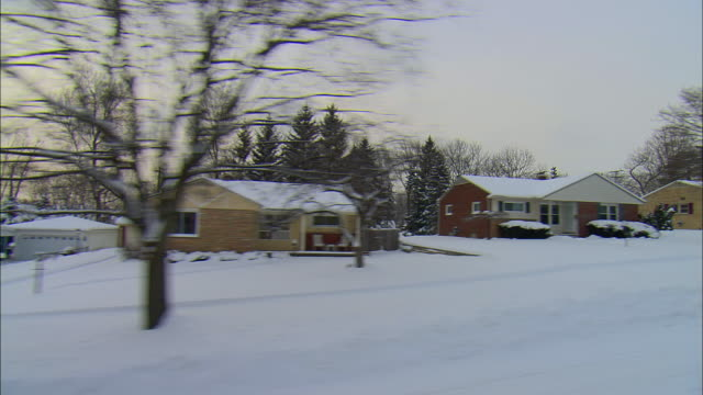 side pov driving through small town residential district in winter, milford, michigan, usa - midwest usa stock videos & royalty-free footage