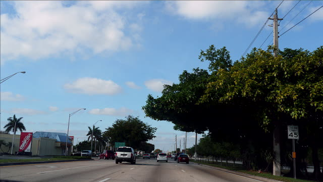 WS POV T/L Driving through state highway and streets / Miami, Key largo, Florida,USA