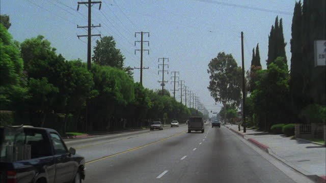 ws pov driving through streets of los angeles passing homes and telephone poles / los angeles, california, usa - telegraph pole stock videos and b-roll footage