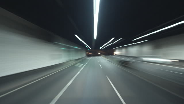 ws pov t/l driving through sydney harbour tunnel to north shore at night / sydney, new south wales, australia - sydney stock videos & royalty-free footage
