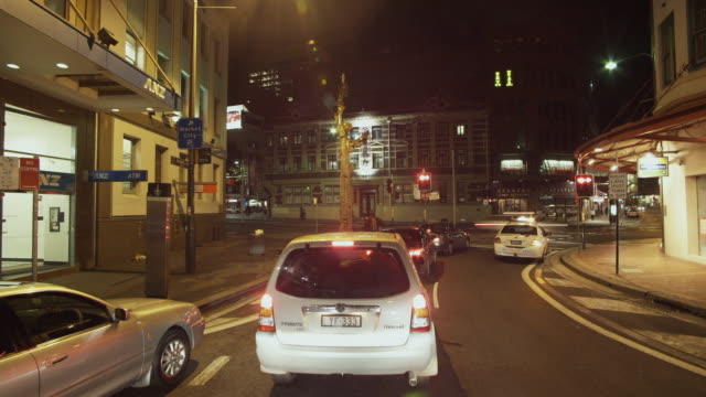 WS POV T/L Driving through Sydney's Chinatown at night / Sydney, New South Wales, Australia