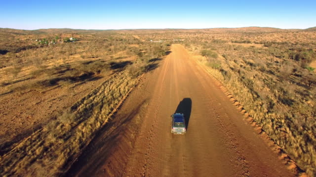 driving through the arid namibian landscape - 4x4 stock videos and b-roll footage