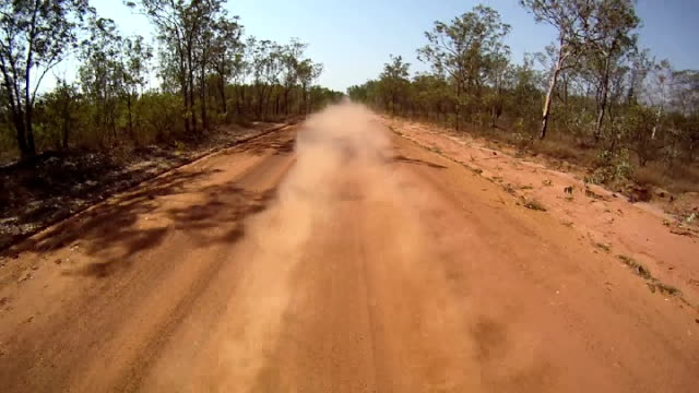 ntsc: driving through the australian outback - dust stock videos & royalty-free footage