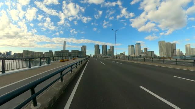 driving through the bridge at sunset - plusphoto stock videos & royalty-free footage