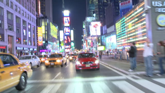 RPOV Driving through the bustling and brightly lit Broadway thoroughfare / New York City, New York, United States