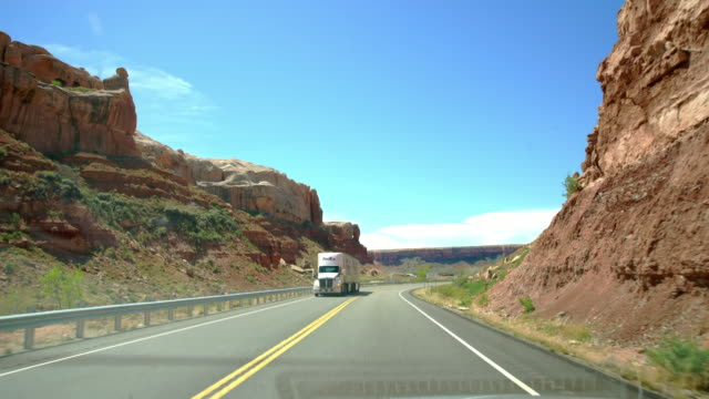 pov driving through the canyonlands national park - canyonlands national park stock videos & royalty-free footage