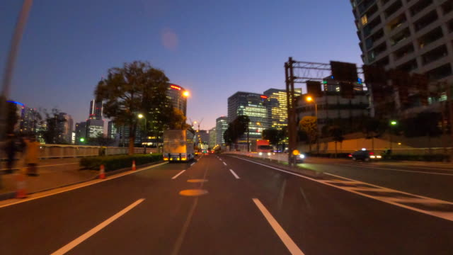 driving through the city at dusk - ultra high definition television stock videos & royalty-free footage