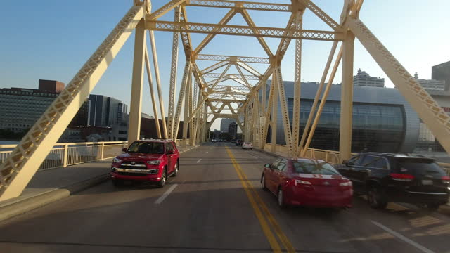 driving through the george rogers clark memorial bridge at sunset past kfc yum center amid the 2020 global coronavirus pandemic on october 7, 2020. - vanishing point stock videos & royalty-free footage