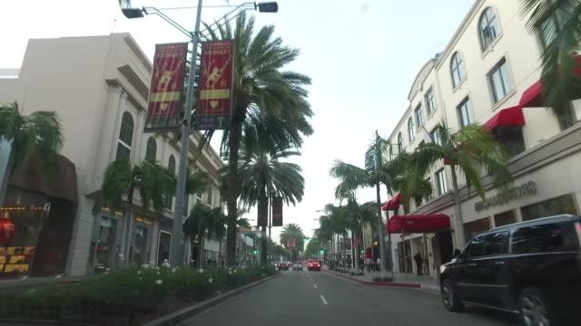 kör genom hollywood boulevard, los angeles, kalifornien - hollywood boulevard bildbanksvideor och videomaterial från bakom kulisserna