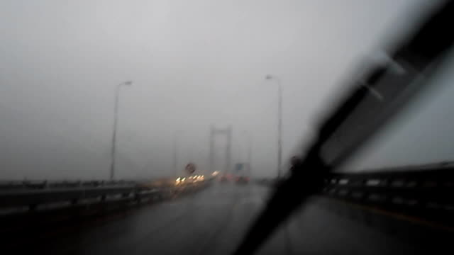 driving through the rande bridge on a rainy day - 1973 stock videos & royalty-free footage