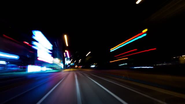 pov, t/l, driving through the streets at night - road signal stock videos & royalty-free footage