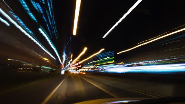 POV, T/L, Driving through the streets at night