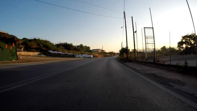 pov driving through the streets of greece - mindre än 10 sekunder bildbanksvideor och videomaterial från bakom kulisserna
