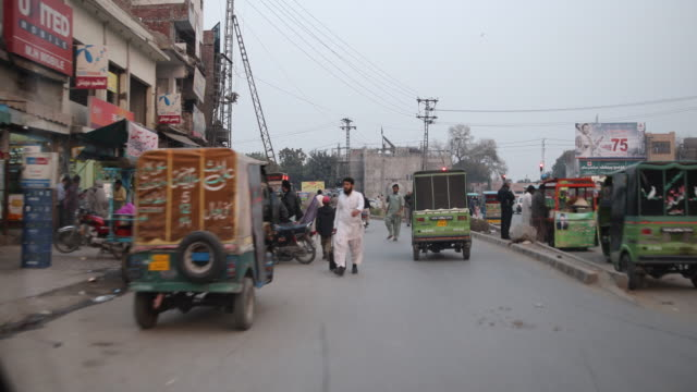 driving through the streets of lahore passing motorcyclists, tuk tuks, cars etc. - punjab pakistan stock videos & royalty-free footage