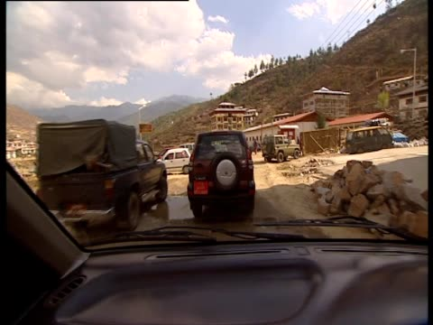 driving through the streets of thimphu in bhutan - thimphu stock videos & royalty-free footage