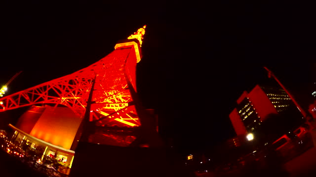 driving through the tokyo tower at night. look up. tokyo tower in tokyo, japan - plusphoto stock videos & royalty-free footage
