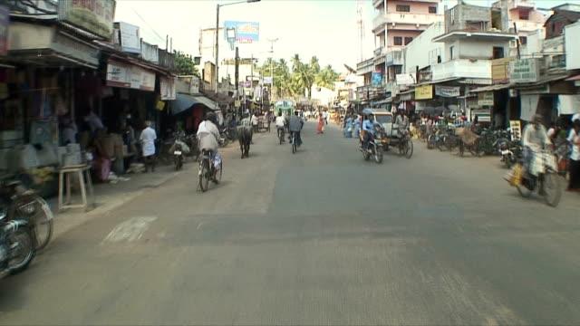 MS POV Driving through traffic on town's street, Pondicherry, India