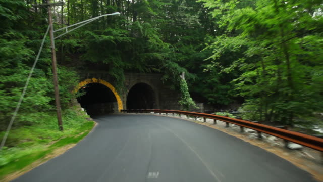 POV Driving through tunnel and rural road / High Bridge, New Jersey, USA