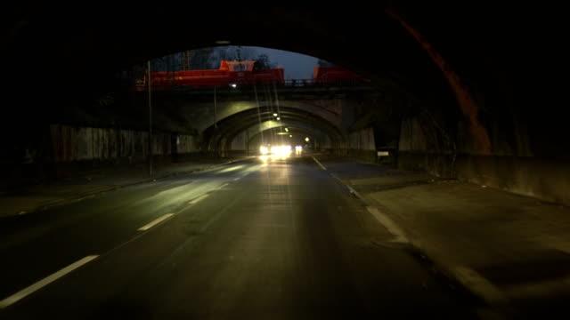 vidéos et rushes de pov driving through tunnels at dusk - véhicule utilitaire léger