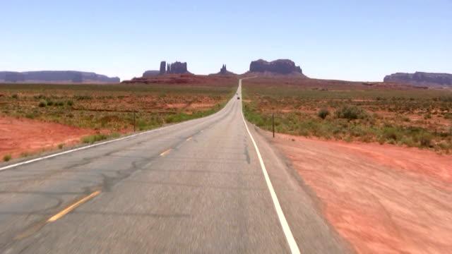 hd: driving through utah desert - monument valley stock videos & royalty-free footage