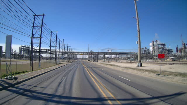 driving through valero and chevron philips chemical plants area amid the global coronavirus pandemic. - power line stock videos & royalty-free footage