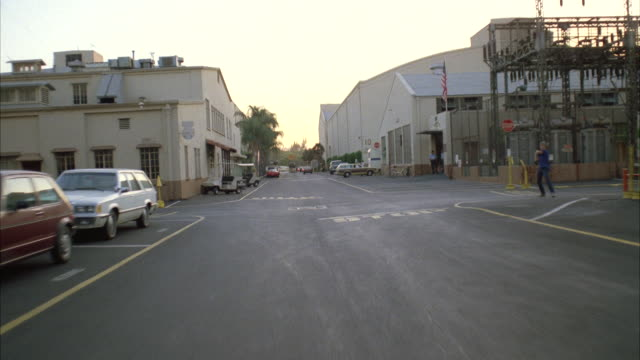 MS POV PAN Driving through warner brothers studio streets