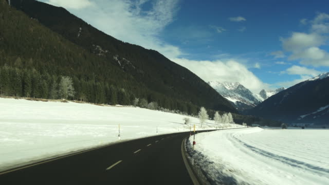hd driving through winter mountain landscape - unterwegs stock videos & royalty-free footage