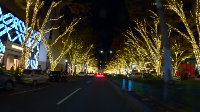 driving through winter night illumination in omotesando, tokyo - street light stock videos & royalty-free footage