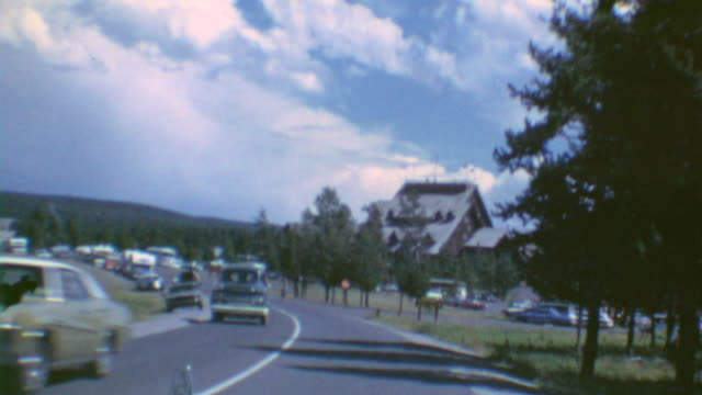 driving to geysers and hot springs / old faithful inn exterior old faithful inn on june 16 1972 in old faithful historic district wyoming - yellowstone national park stock videos & royalty-free footage