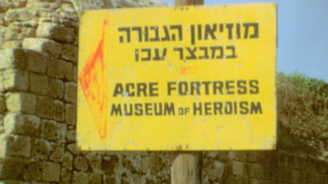 Driving to Port in Acre / Giant Grape Logo on Taxi Cab / Signage for Acre Fortress Museum of Heroism / Signage for Central Prison Acre / Touring the...