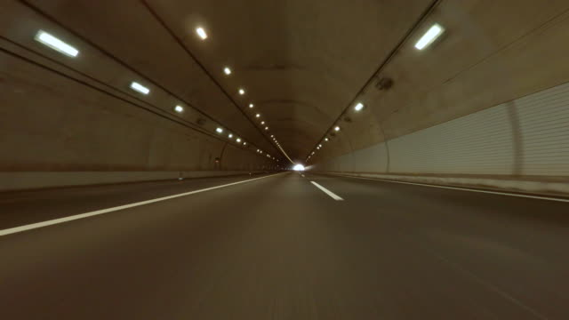 driving to tunnel -4k- - tunnel stock videos & royalty-free footage