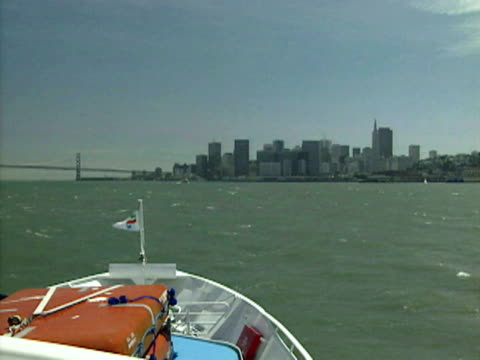 Driving toward San Francisco while aboard a ferry boat