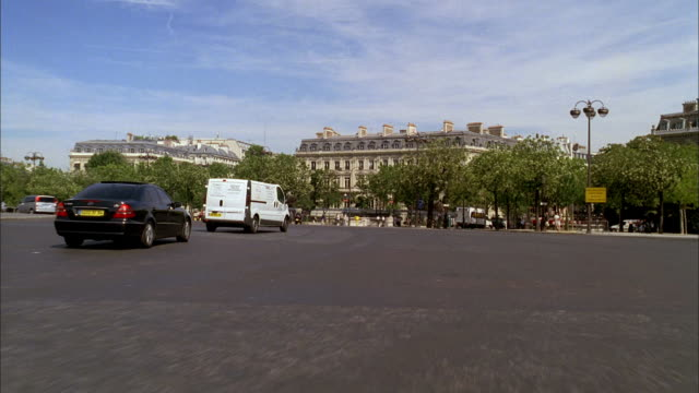POV Driving toward the Arc de Triomphe and joining the traffic circle of the Place Charles de Gaulle / Paris, France
