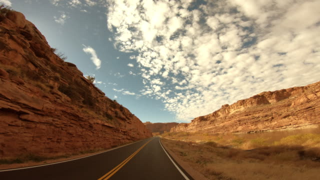 driving towards arches national park, moab, utah - dividing line stock videos & royalty-free footage