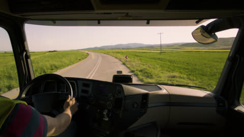 driving truck on the road in beautiful countryside - vehicle interior stock videos & royalty-free footage