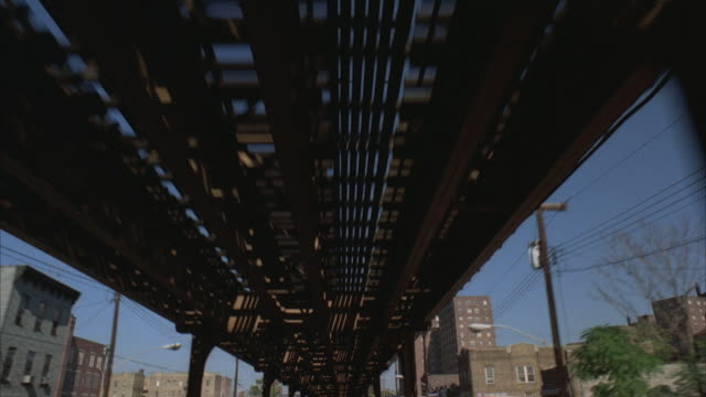 POV, driving under elevated train tracks, Bronx, New York City, New York, USA