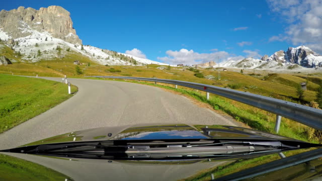 driving up a mountain pass in dolomites, italy - curve stock videos and b-roll footage
