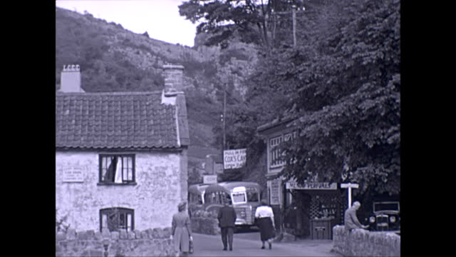 driving up through the somerset village of cheddar past cox's cave and various cheddar cheese shops - geology stock videos & royalty-free footage