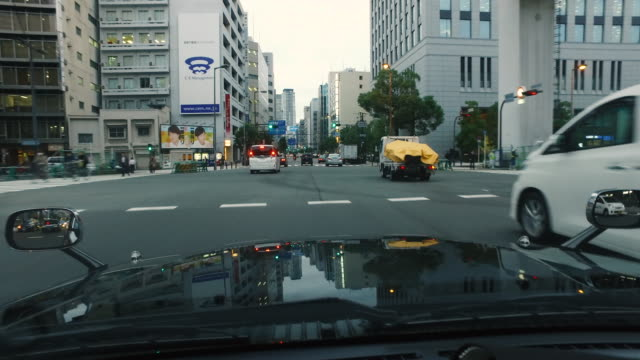 driving urban road by car - road signal stock videos & royalty-free footage
