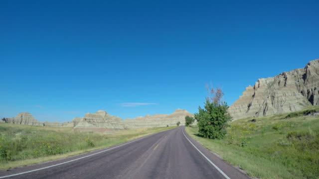 pov driving vehicle highway badlands south dakota usa - south dakota stock-videos und b-roll-filmmaterial