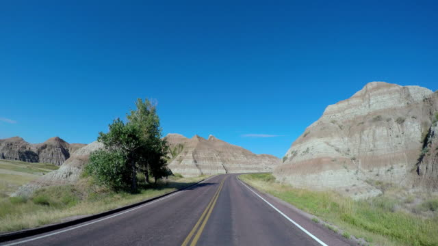 pov driving vehicle highway badlands south dakota usa - south dakota stock videos & royalty-free footage