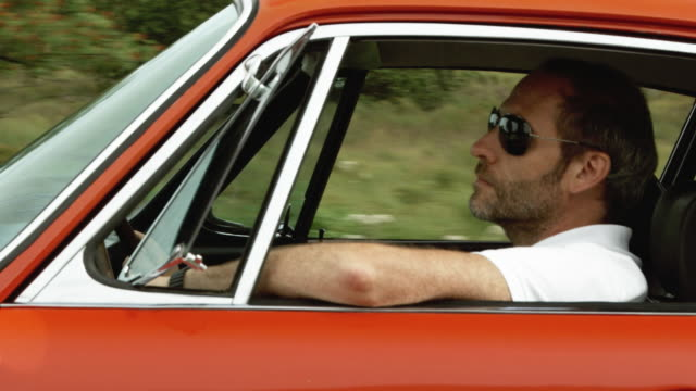 driving (shot on red) - collector's car stock videos & royalty-free footage