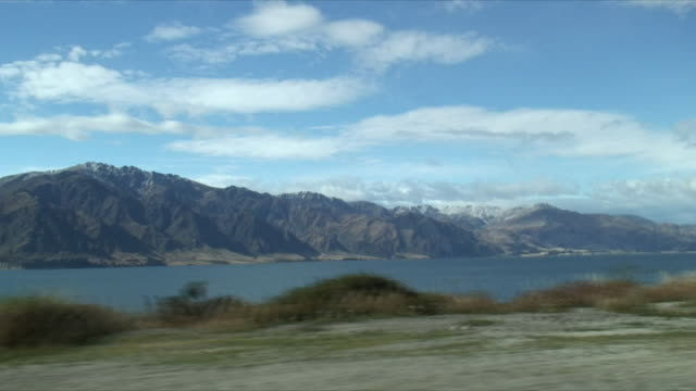 pov ws driving view of lake hawea, otago, new zealand - car point of view stock videos & royalty-free footage