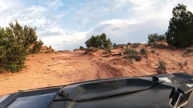 driving with an atv in moab - 4x4 stock videos & royalty-free footage