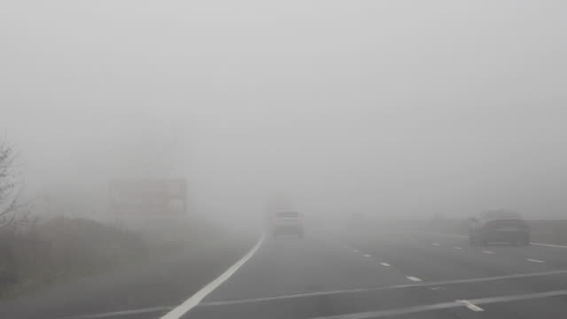 driving/process plates driving in fog on a uk motorway - somerset england stock videos & royalty-free footage