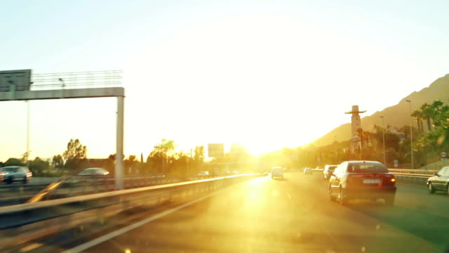 driving/process plates. returning home at sunset. - 逆光点の映像素材/bロール