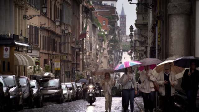 a drizzling day in a roman street - cars parked in a row stock videos & royalty-free footage