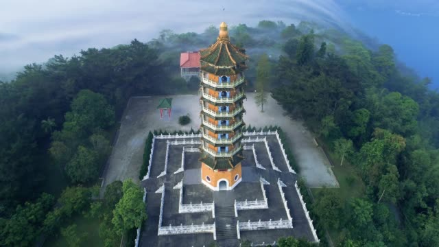 drone 360 degree of pa cien pagoda with sun moon lake , nantou, taiwan - taiwan stock videos & royalty-free footage