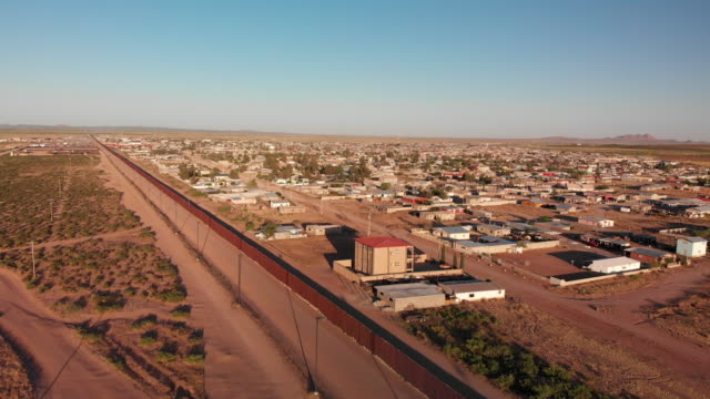 drone 4k sunset footage of the border wall between the united states and mexico at the crossing of palomas chihuahua and columbus new mexico - northern mexico stock videos & royalty-free footage