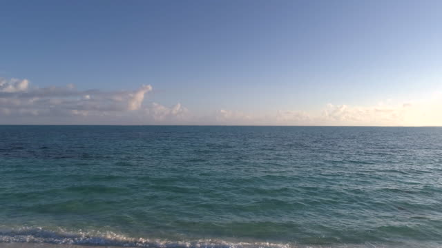 drone aerial 4k view of perfect beach with clear blue water at dawn in slow motion - grace bay stock videos and b-roll footage